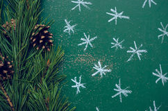 Chalk painted Christmas balls on the green background. Royalty Free Stock Photography