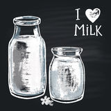 Chalk painted illustration milk bottle. The phrase chalk: I love milk Stock Photo