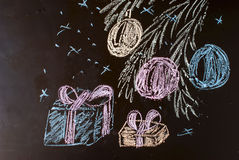 Chalk painted spruce paw with balloons and gifts on a black back Royalty Free Stock Images