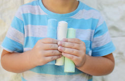 Chalk paints. Kid holding colored chalk paints for drawing Stock Images