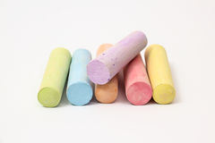 Chalk. Pastel colored chalk sticks on a white background stock photos