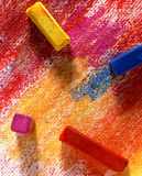 Chalk pastels. Chalk pastel sticks on colored canvas Royalty Free Stock Photos