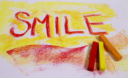 Chalk pastels with word smile Stock Image