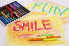 Chalk pastels with words smile and fun Stock Photos