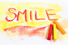 Chalk pastels with word smile Royalty Free Stock Image