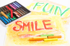 Chalk pastels with words smile and fun Stock Photo