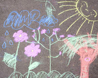 Chalk picture paiting on concrete. A detail of a child's colorful chalk picture on the pavement Stock Photos