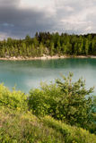 Chalk quarry filled with water in Belarus. Royalty Free Stock Photo