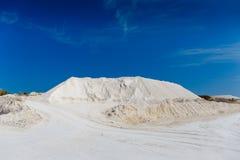 Chalk quarry. White sand hill, roads, blue sky. Limestone mining or desert Stock Images