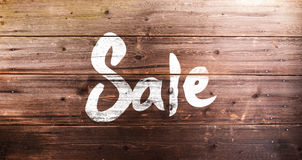 Chalk sale sign. Studio shot on wooden background Stock Photography