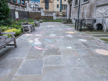 Chalk sidewalk art in St Andrew Holborn churchyard, London Stock Photos
