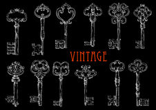 Chalk sketched antique skeleton keys on chalkboard Royalty Free Stock Image
