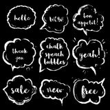 Chalk speech bubbles set with short phrases(hello, wow, bon appetit, thank you, yeah, sale, new, free). Royalty Free Stock Photos