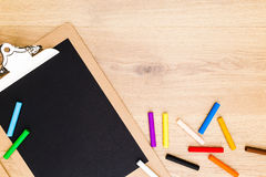 Chalk sticks and clipboard Royalty Free Stock Image