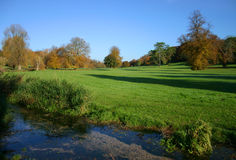 Chalk Stream. Flowing gently through autumn parkland Stock Photos