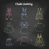 CHALK style icons. Set of cute dresses for the little girl. Collection of clothing in a linear style for the child. Stock Photo