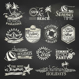 Chalk summer and vacation labels and emblems. Vector travel emblems, symbols, badges and logo templates on blackboard background Stock Photography