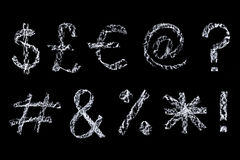 Chalk symbols on blackboard Royalty Free Stock Photo
