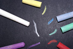 Chalk and taxtured black paper Stock Photos