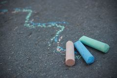 Chalk on Textured Asphalt. Colorful Draw Lines. Childhood and parenting. Education. royalty free stock image