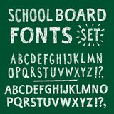 Chalk textured hand drawn font. Hand drawn chalk textured ABC letters set. Comic school font on green board background for your design Stock Illustration