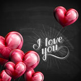 Chalk typographic illustration of handwritten I love you retro label. lettering on the blackboard with flying heart balloons Stock Photo