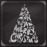 Chalk We Wish You a Merry Christmas tree design. Hand-drawn Christmas lettering on blackboard. Vector illustration Royalty Free Stock Photos