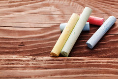Chalk on wooden background Stock Photo