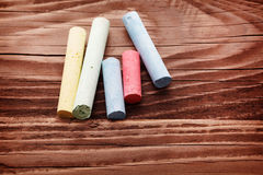 Chalk on wooden background Royalty Free Stock Photo