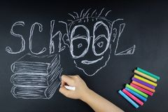Chalk word Board school. Child chalk writes on the Board the word school stock photo