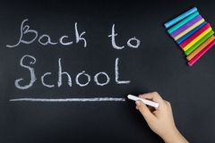Chalk word Board school. Child chalk writes on the Board the word school royalty free stock photography