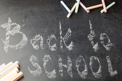 Chalk with the words back to school. Chalk with back to school inscription on the wooden background stock photo