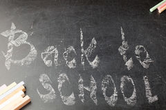 Chalk with the words back to school. Chalk with back to school inscription on the wooden background Royalty Free Stock Image