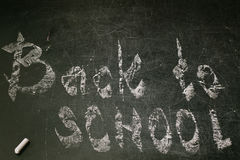 Chalk with words back to school. An inscription written in chalk back to school on an old blackboard Royalty Free Stock Photo