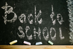 Chalk with words back to school. An inscription written in chalk back to school on an old blackboard Royalty Free Stock Photography