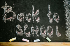 Chalk with words back to school. An inscription written in chalk back to school on an old blackboard Royalty Free Stock Images