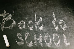 Chalk with words back to school. An inscription written in chalk back to school on an old blackboard Stock Images
