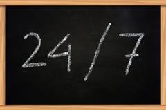 24/7 Chalk Writing on Blackboard Stock Photos
