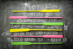 Chalk written drink menu on concrete wall Royalty Free Stock Images