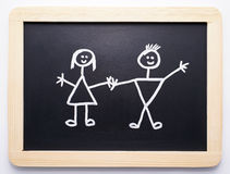 Chalkboard. An isolated chalkboard with boy and girl drawing Royalty Free Stock Photos