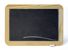 Chalkboard. Small old chalkboard and piece of chalk over white background Royalty Free Stock Photography