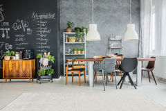 Chairs in eclectic dining room Stock Photography