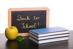Chalkboard, apple  and  books Royalty Free Stock Images