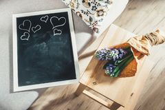 Chalkboard as background for congrats with mother or valentine d. Ay and hyacinth flowers royalty free stock image