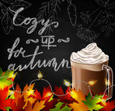 Chalkboard with autumn leaves Stock Image