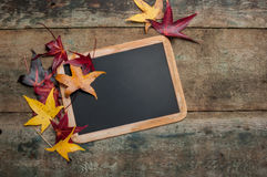 Chalkboard with autumn leaves Stock Photo