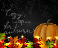Chalkboard with autumn leaves and pumpkin Stock Photography