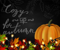 Chalkboard with autumn leaves and pumpkin Royalty Free Stock Images