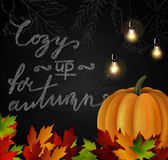 Chalkboard with autumn leaves and pumpkin Stock Image