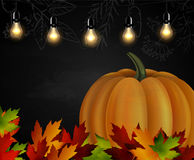 Chalkboard with autumn leaves and pumpkin Royalty Free Stock Photography